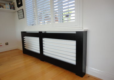 Unique black made to measure radiator cabinet with white slats